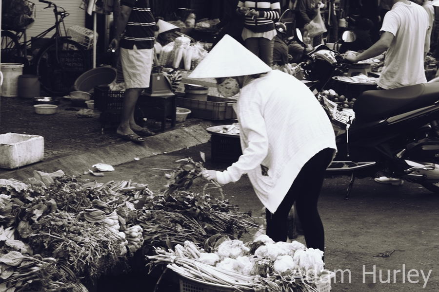Vege shopping in local Saigon market.............. Saigon, Vietnam