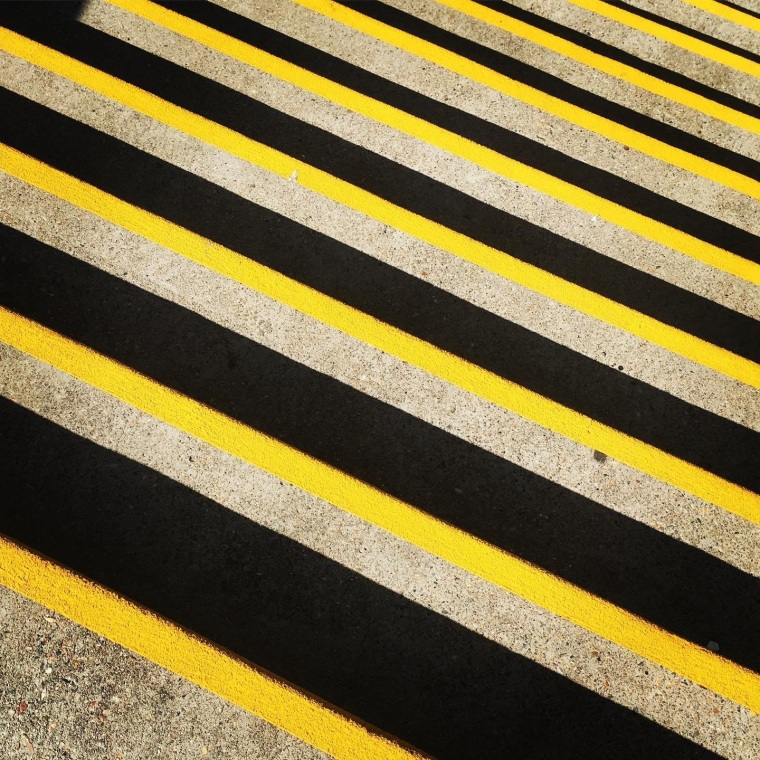 Stairs with black and yellow safety tape