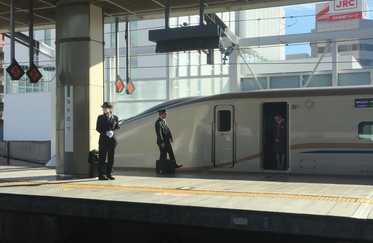 Japanese train crew ready for shift change.